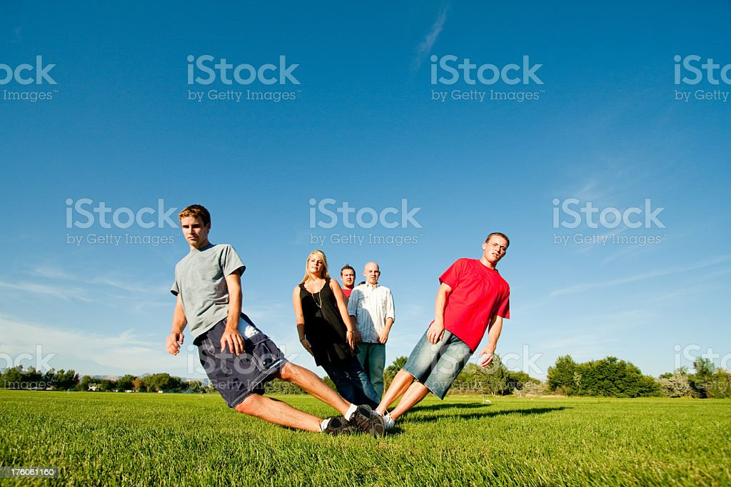Teens Posing and Falling in a Field royalty-free stock photo