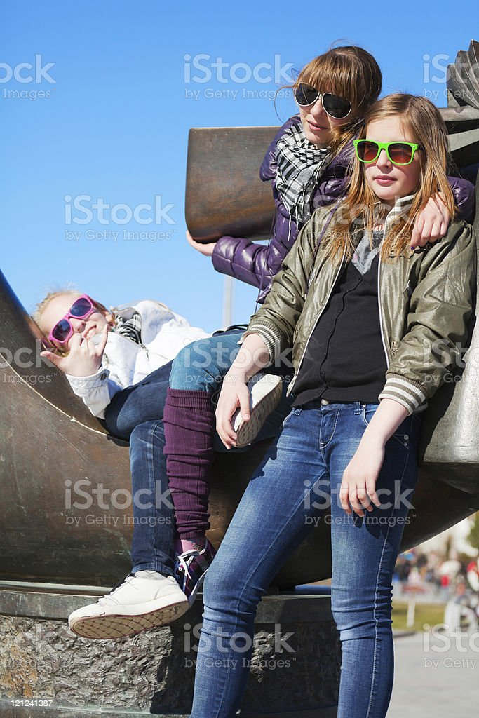 Teens relaxing on the monument royalty-free stock photo