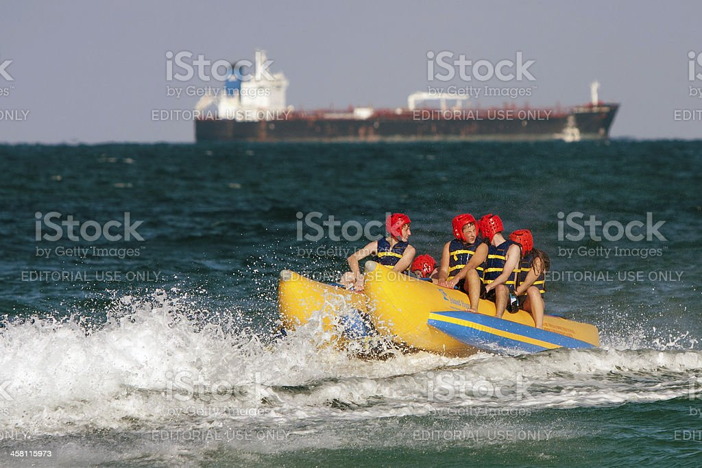 Teens Riding a Banana Boat off Ft. Lauderdale Beach royalty-free stock photo