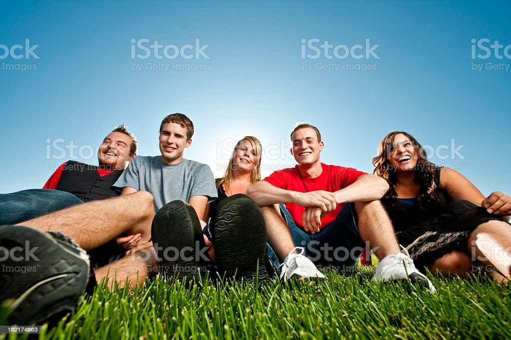 Teens Sitting on the Grass stock photo