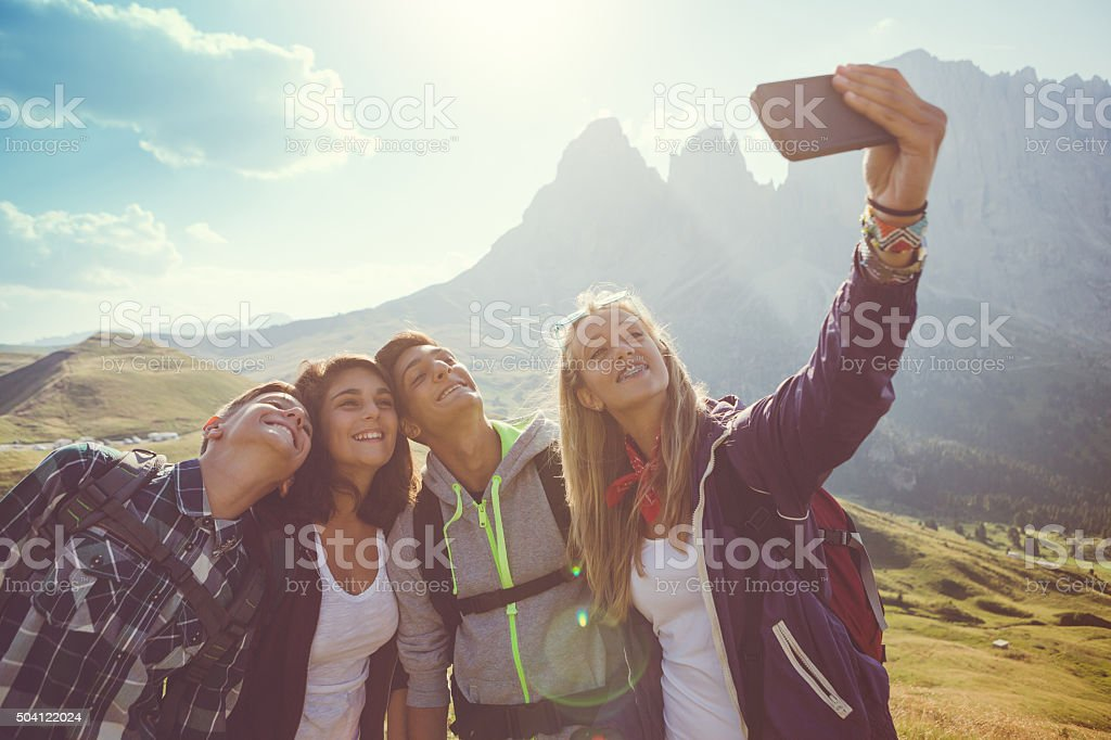 Teens take a selfie on the Dolomites stock photo