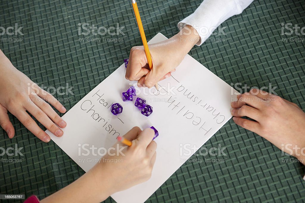 Teens Together for Role Playing Dice Game stock photo