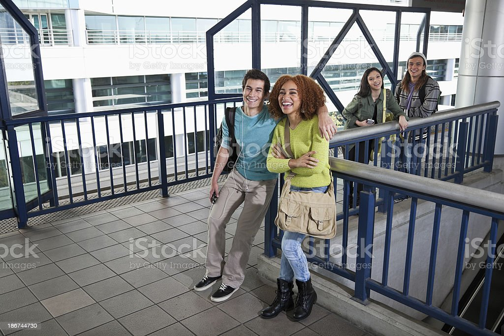 Teens waiting for tram stock photo