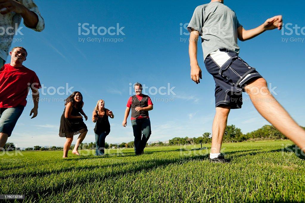 Teens Walking in a Field stock photo