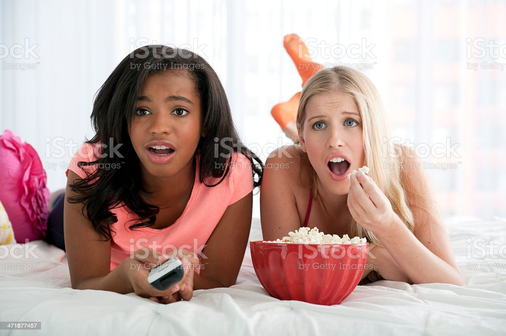 Teens watching television royalty-free stock photo