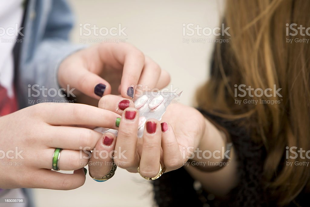Teens with pills royalty-free stock photo