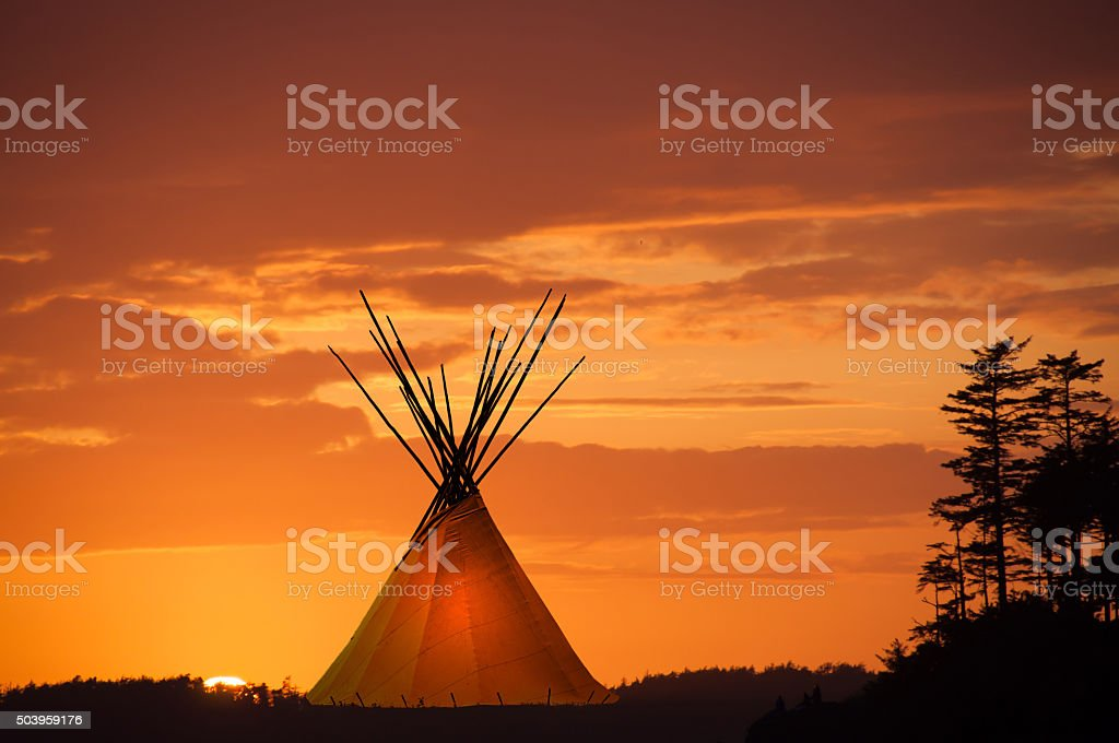Teepee and gold sunset- light in teepee stock photo