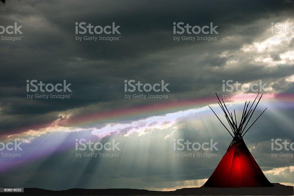 Teepee and raining, dark,  sunset, rainbow, light in teepee stock photo