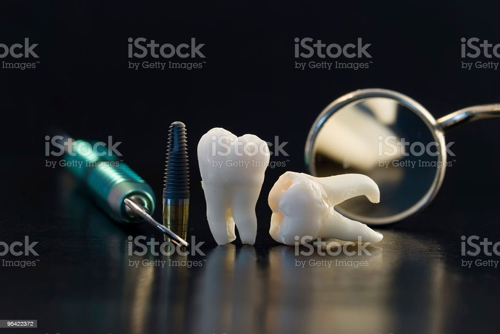 teeth and dental instruments stock photo