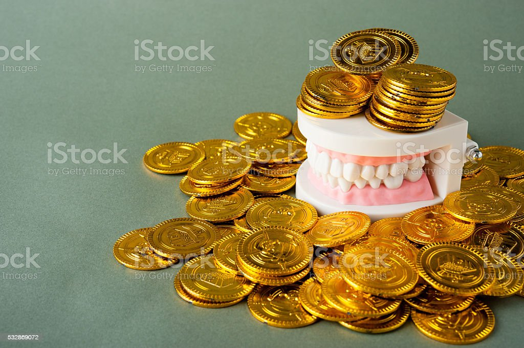 Teeth and money stock photo