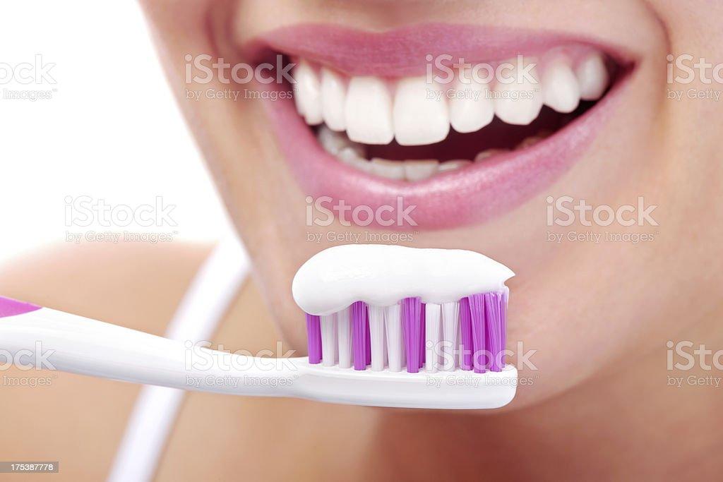 Teeth brushing stock photo