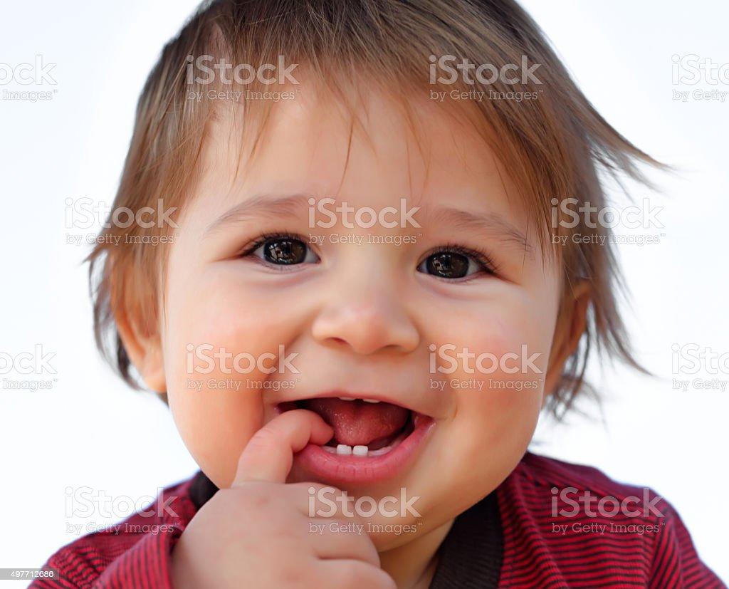 Teethe baby stock photo