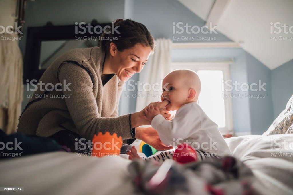 Teething On Mum stock photo