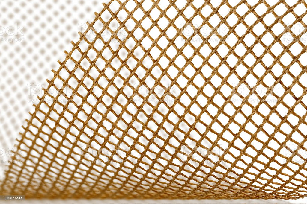 Teflon open mesh fabric on white background stock photo