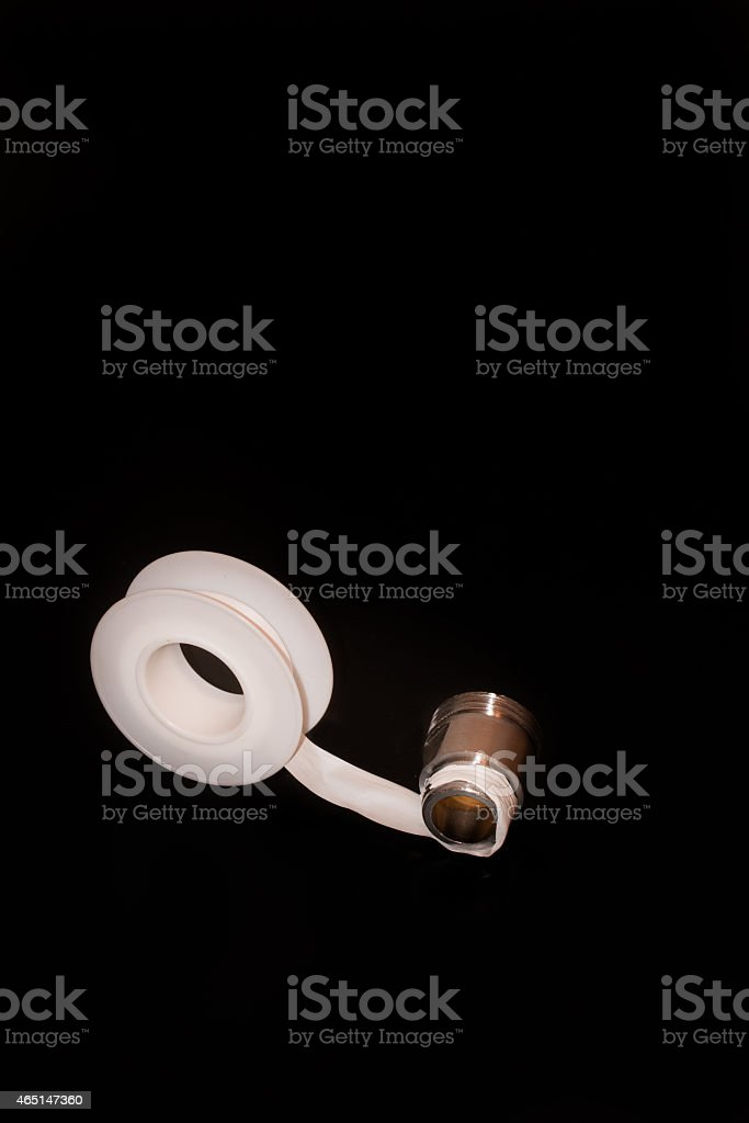 teflon tape or plumber tape applicated on a thread stock photo