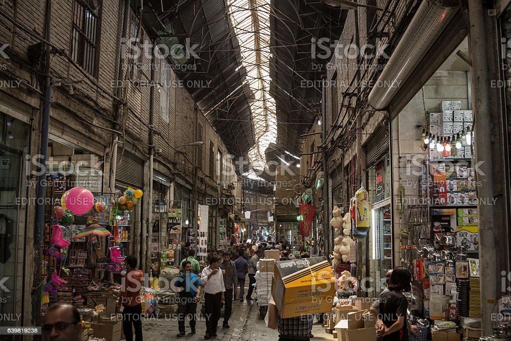 Tehran bazaar with warm colors & iranians walking stock photo