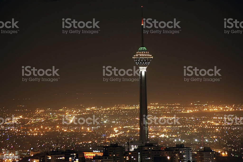 Tehran skyline and illuminated Milad Tower at night stock photo