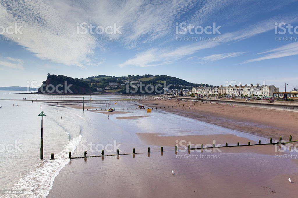 Teignmouth beach Devon England UK with blue sky stock photo