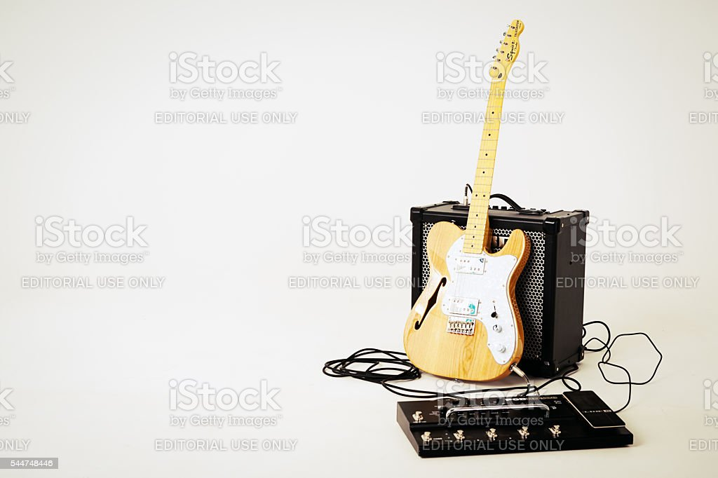 Telecaster Thinline electric guitar with Roland amplifier and multi-effects unit. stock photo