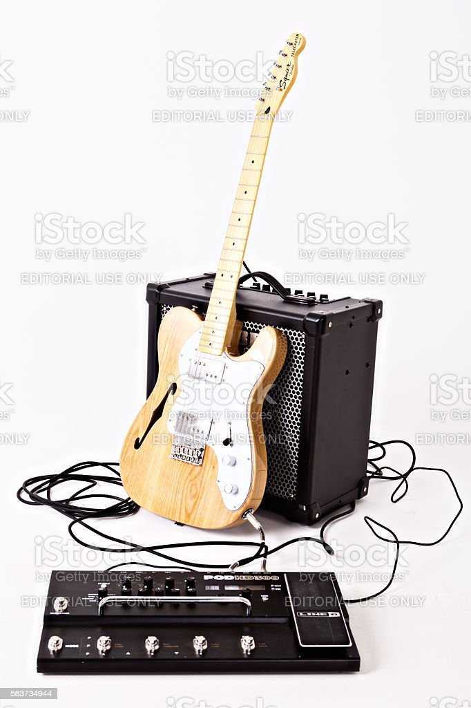 Telecaster Thinline electric guitar with Roland amplifier and multi-effects unit stock photo