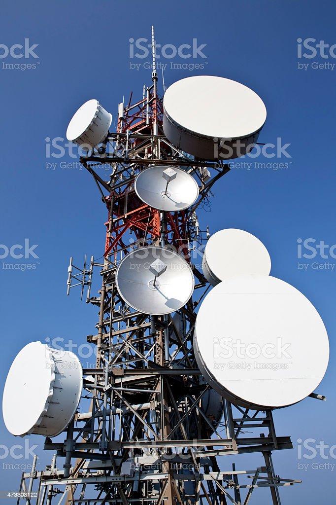Telecommunication and satellite tower stock photo