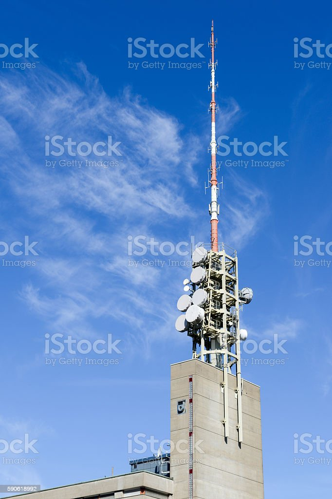 Telecommunication antenna with microwave link antennas stock photo