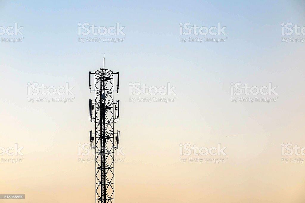 Telecommunication cellular tower on twilight background. Used to stock photo