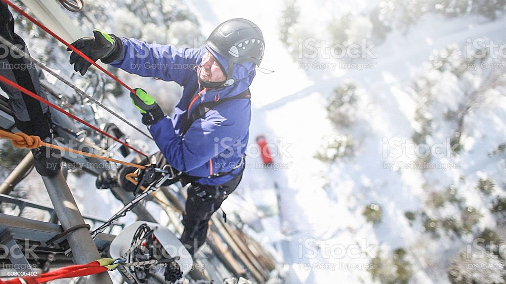 Telecommunication manual high worker engineer climbing an antenna stock photo