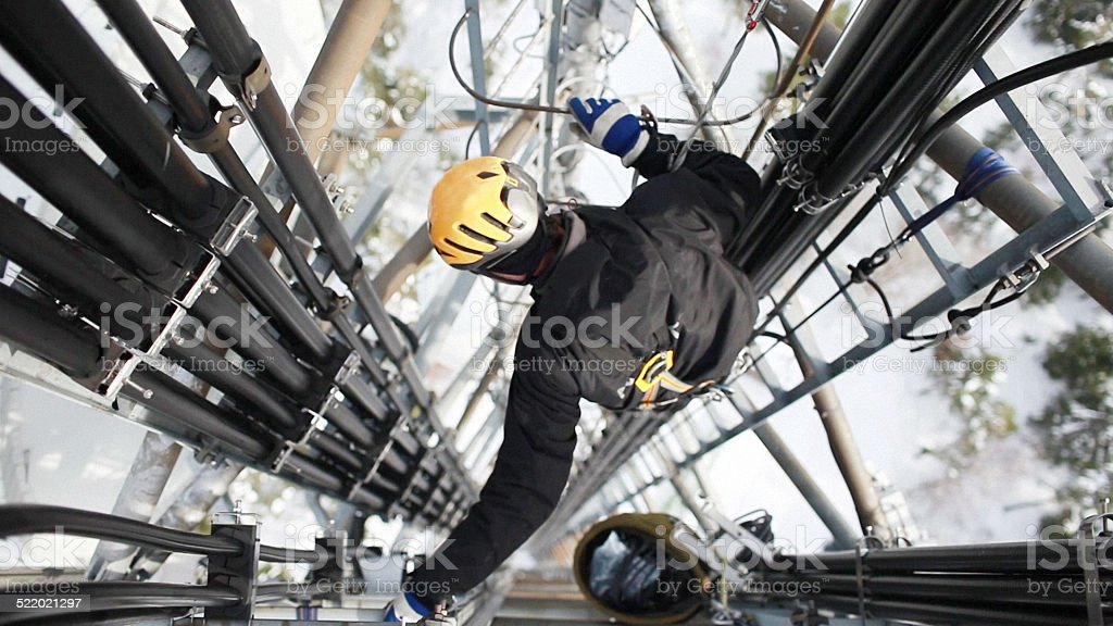 Telecommunication manual high worker engineer repairing antenna stock photo