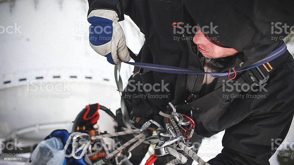 Telecommunication manual high worker engineer repairing antenna stock photo