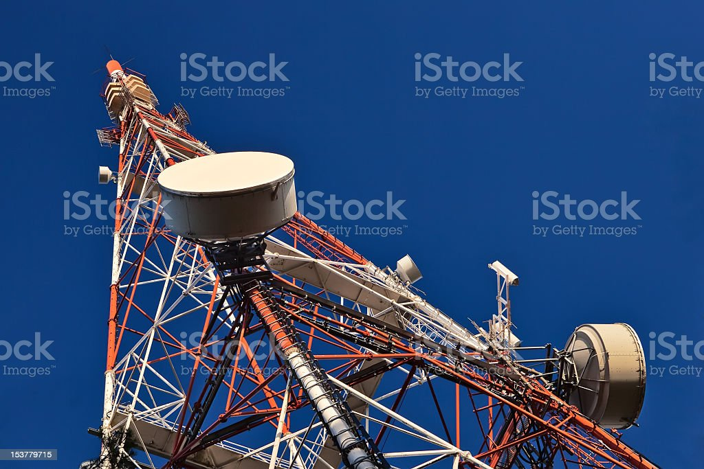 Telecommunication mast against a clear blue sky royalty-free stock photo