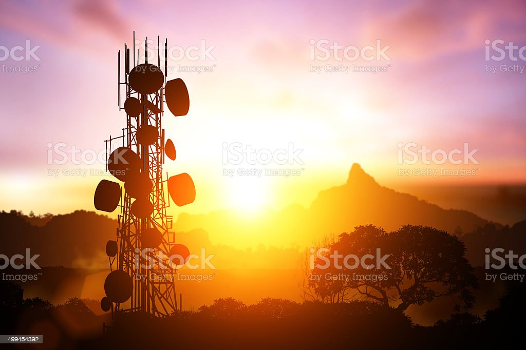 Telecommunication mast television antennas on sunset stock photo