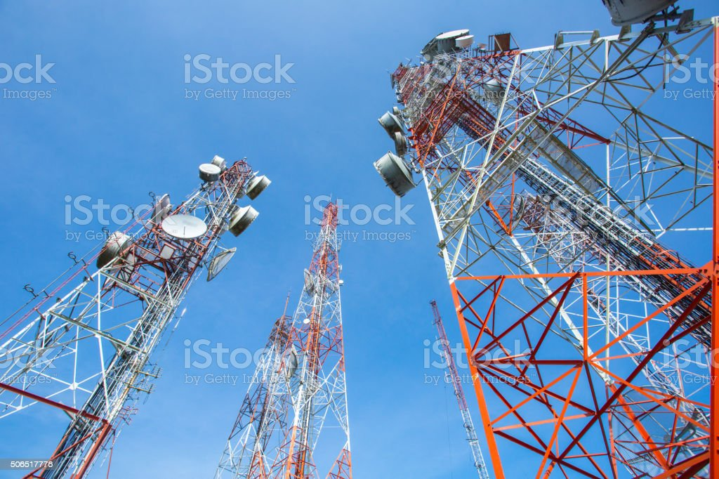 Telecommunication mast TV antennas with blue sky stock photo