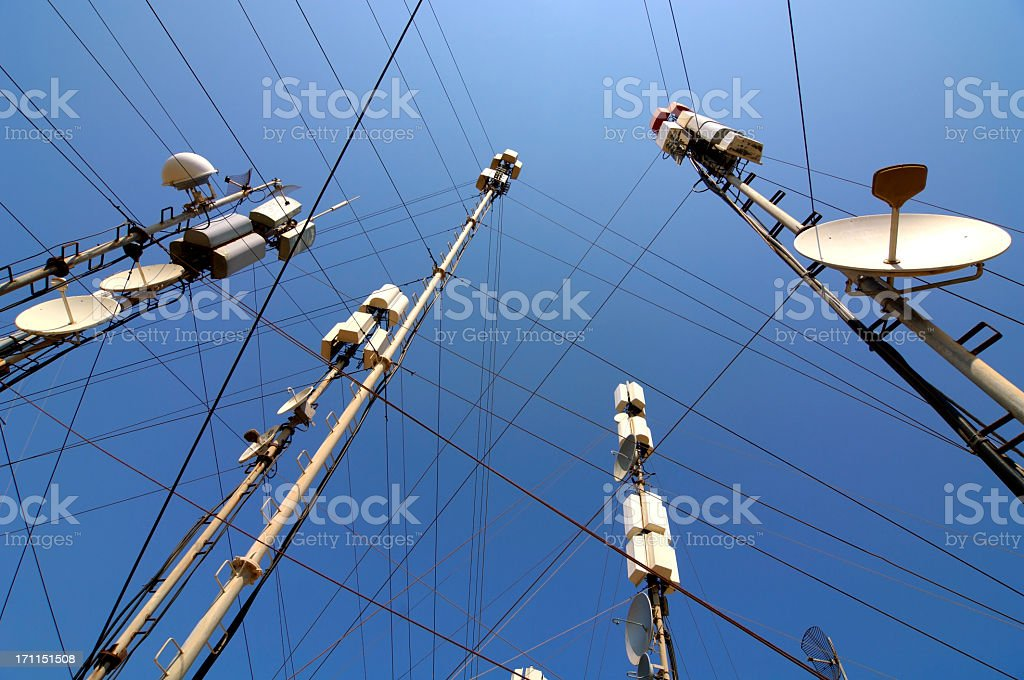 Telecommunication masts and satellites seen from below stock photo