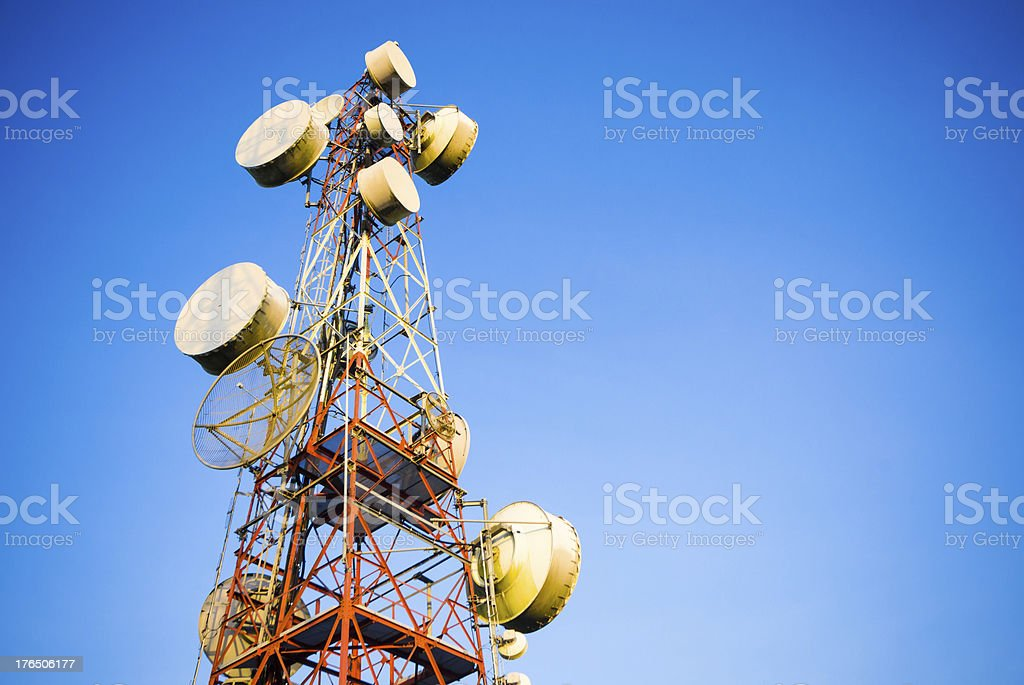 Telecommunication tower against the blue sky stock photo