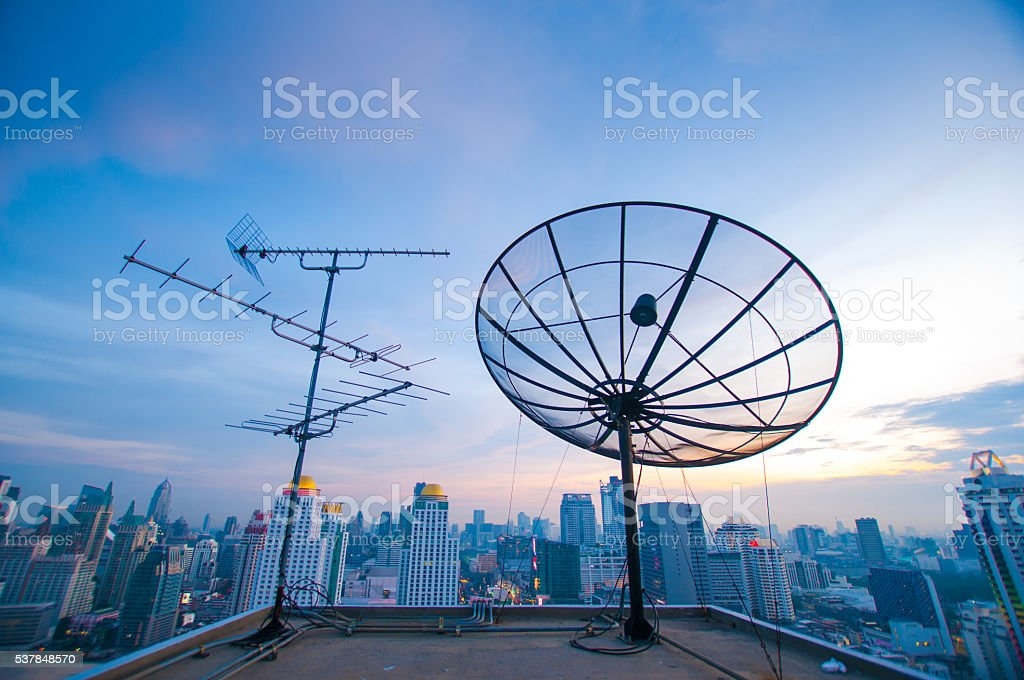 Telecommunication tower in the city stock photo
