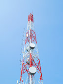 Telecommunication tower on clear blue sky