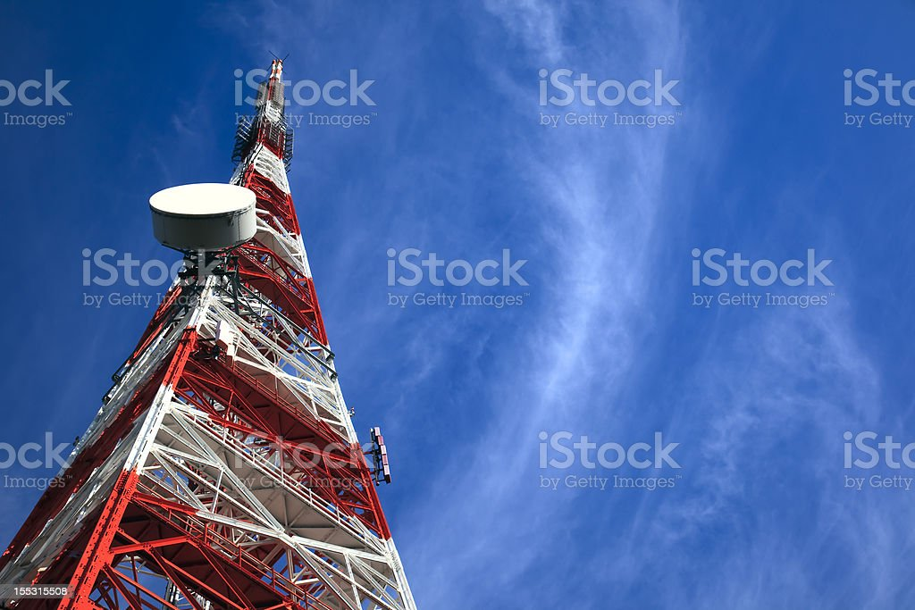 Telecommunication Tower on blue sky and clouds stock photo
