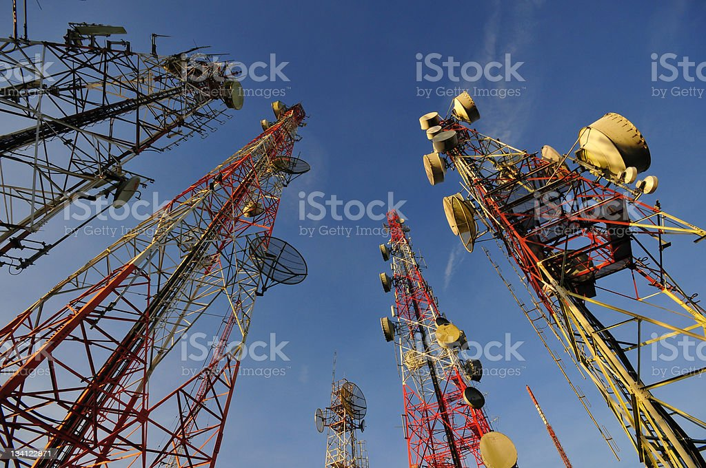 Telecommunication tower with a bit morning sunlight stock photo