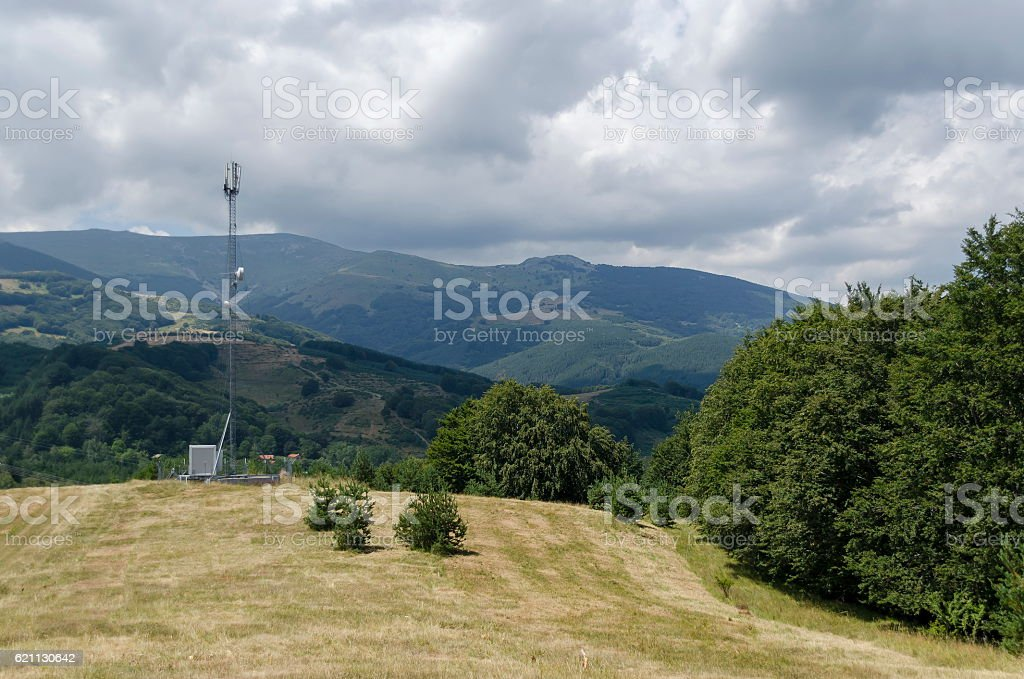 Telecommunication tower with antenna of advance summer stock photo