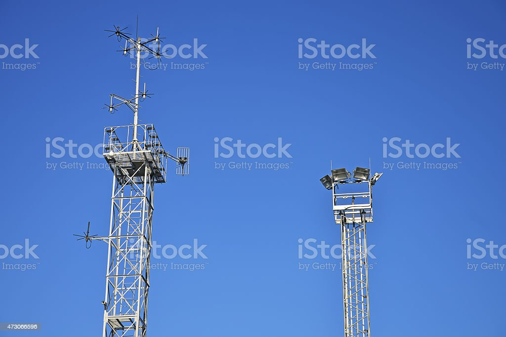 Telecommunication tower with antennas over blue sky. stock photo