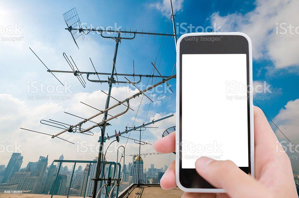Telecommunication tower with smart phone stock photo