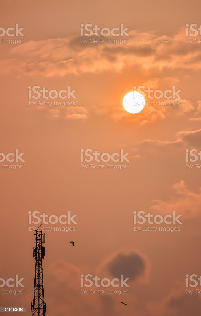 Telecommunication tower with sunset stock photo