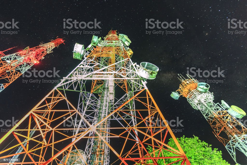 Telecommunication towers for mobile communications and TV antennas stock photo