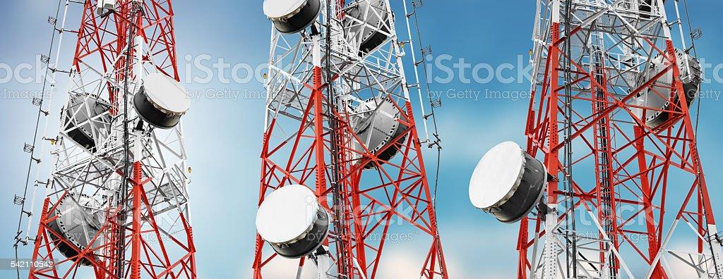 Telecommunication towers with TV antennas and satellite dish stock photo