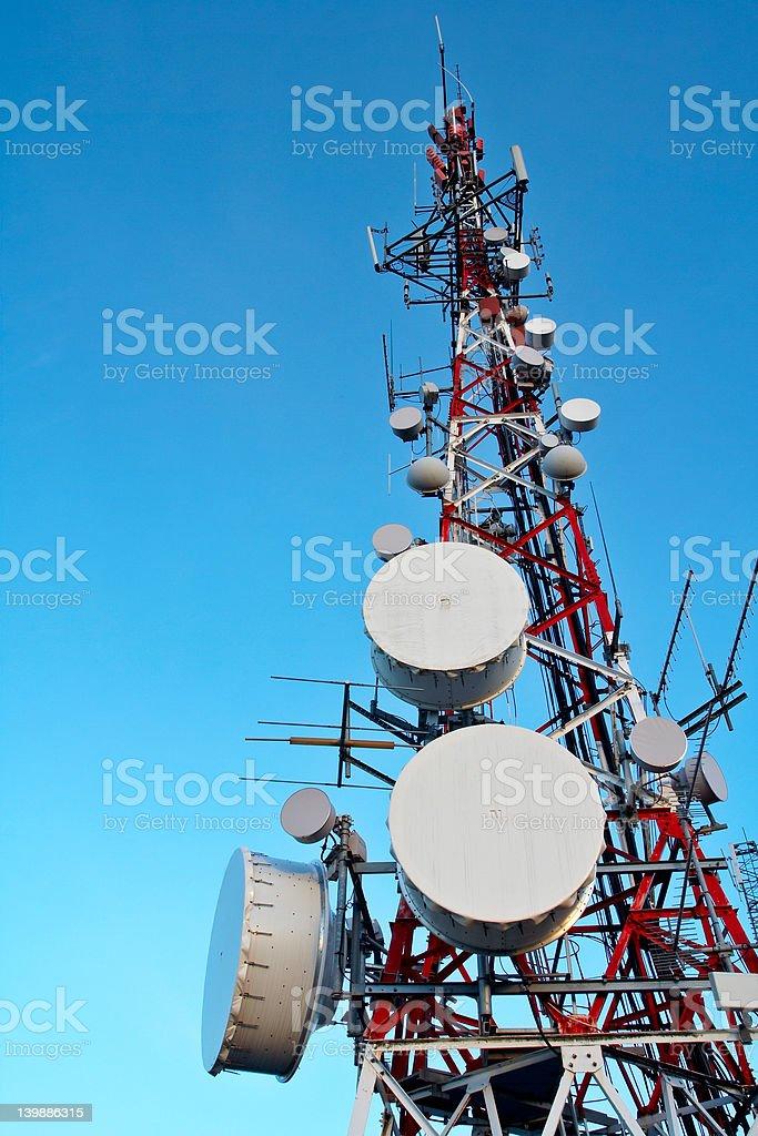 Telecommunications antennas tower royalty-free stock photo