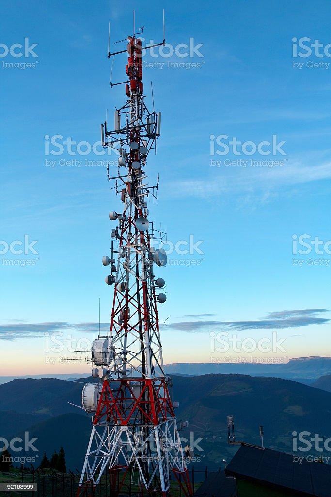 Telecommunications antennas tower stock photo