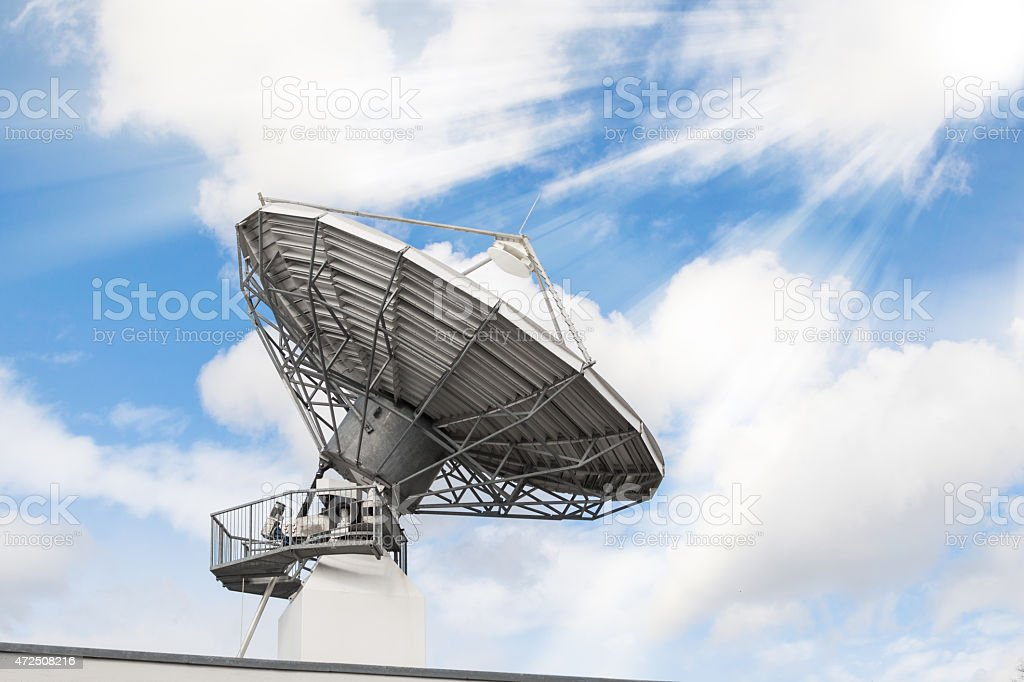 Telecommunications radar parabolic radio antenna stock photo