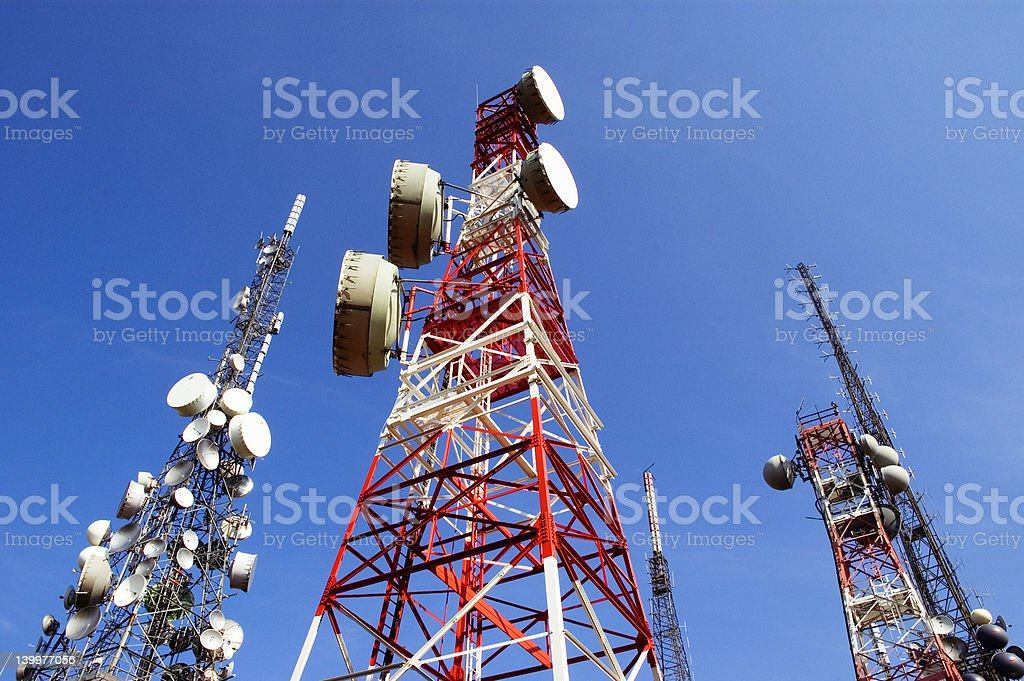 Telecommunications Tower, blu skye with clouds stock photo