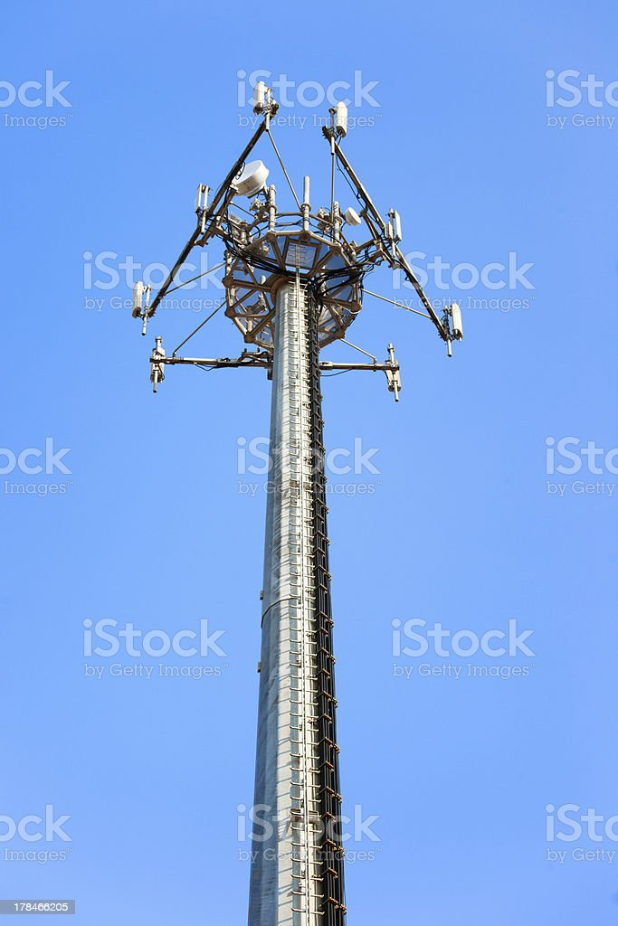 Telecommunications tower. Mobile phone station on a blue sky royalty-free stock photo